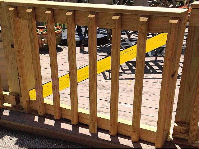 Photo of a deck handrail gate.