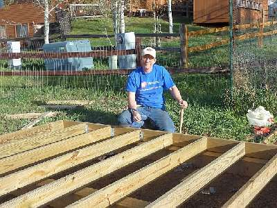 Photo of our member constructing the floor of the gable shed.