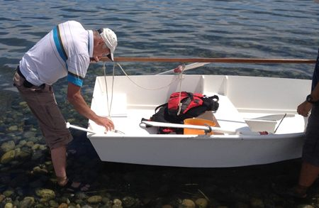 Photo of Dave preparing his sabot boat.