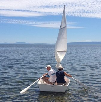 Photo of Dave and his step-son in the sabot boat.