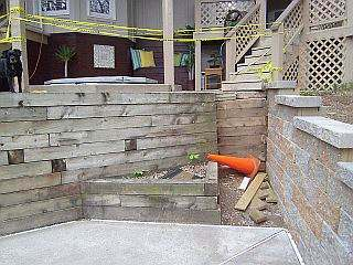 Photo of where stairs will go between brick walls.