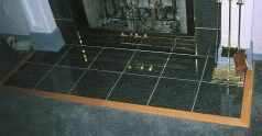 Thumbnail size photo of floor tiles around hearth or fireplace.
