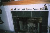 Thumbnail size photo of fireplace mantle.