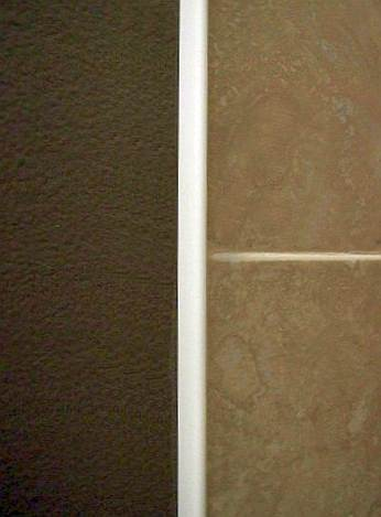 Photo of trime around wall tile.