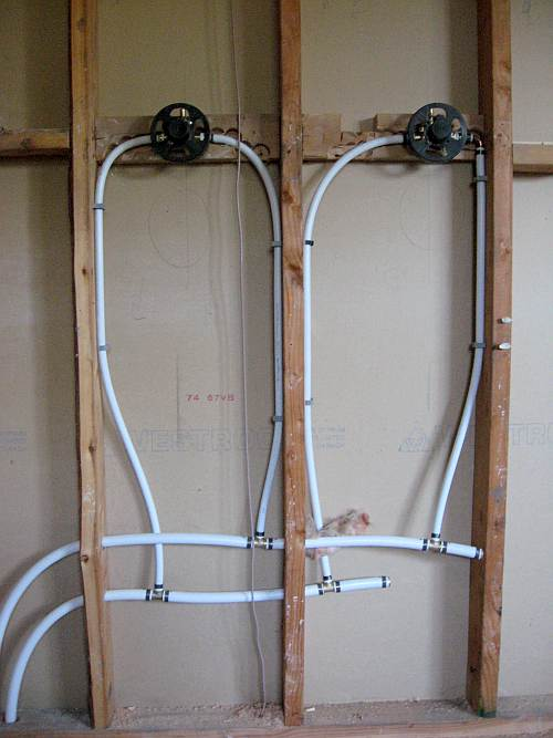 Photo of what the water supply for a shower looks like behind the wall.