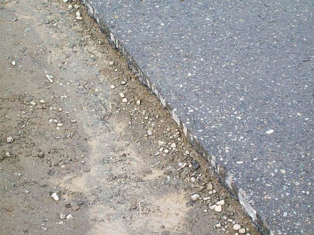 Photo of the edge of Daves driveway before the concrete curb was formed and poured.