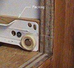 Photo of packing behind a drawer slide.